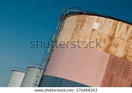oil tanks in blue sky background - stock photo