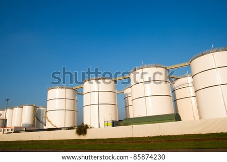 Oil tanks in the harbor of Rotterdam. - stock photo