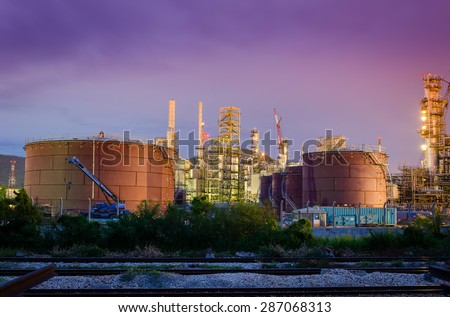 Oil tanks in  the refinery is running at night - stock photo