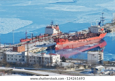 Oil terminal a ship with cargo of oil in the winter in the ice, the port of Nakhodka, Russia - stock photo