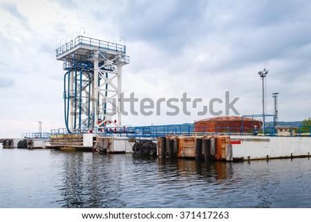 Oil terminal. Equipment for tankers loading in Varna port, Bulgaria - stock photo