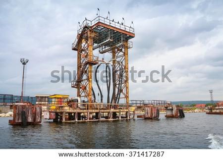 Oil terminal. Equipment for tankers loading on Black sea coast in Varna port, Bulgaria - stock photo