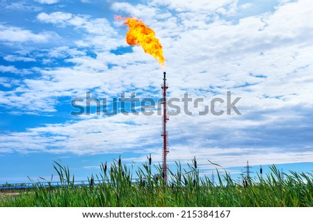 Oil torch on background of cloudy sky - stock photo