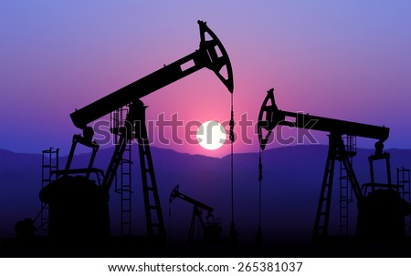 oil well plant against sunset - stock photo