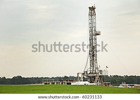 Oil well, rig, field, grass, green, sky, energy, drilling, gray, pump, equipment, swell head, horizontal format, - stock photo