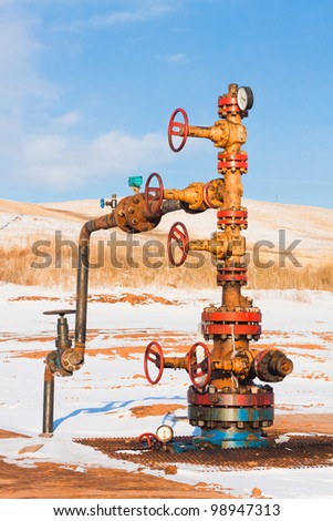 Oil Wellhead, winter, Orenburg region, Russia - stock photo