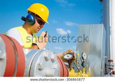 Oil worker in industrial oil  - stock photo