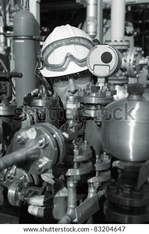 oil worker inside refinery, pipeline pump machinery - stock photo