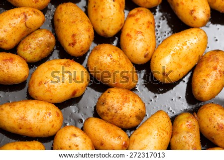 Oiled potato on the tablet - stock photo