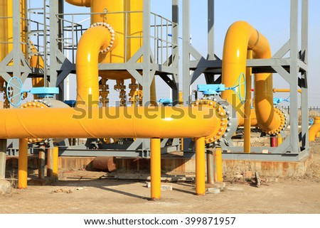Oilfield equipment and pipeline - stock photo