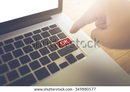 OK word and Man hand press the button. - stock photo