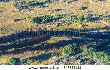 Okavango delta (Okavango Grassland) is one of the Seven Natural Wonders of Africa (view from the airplane) - Botswana, South-Western Africa - stock photo