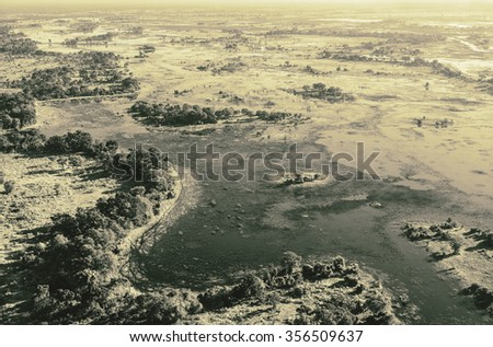 Okavango delta (Okavango Grassland) is one of the Seven Natural Wonders of Africa (view from the airplane) - Botswana, South-Western Africa (stylized retro) - stock photo