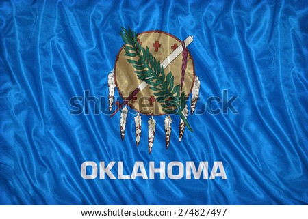 Oklahoma flag pattern on the fabric texture ,vintage style - stock photo