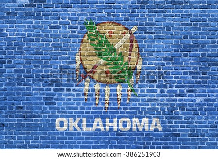 Oklahoma US flag painted on old vintage brick wall - stock photo