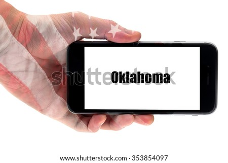 Oklahoma word write on smart phone. Oklahoma - U.S. States - stock photo