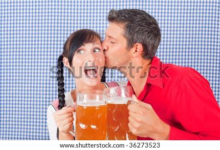 Oktoberfest beerfest couple kissing bavarian festival people - stock photo