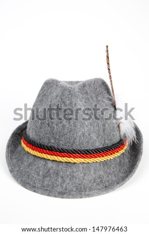 oktoberfest german hunting hat with feathers and three ropes colored in the national colors of Germany - isolated on white background - stock photo