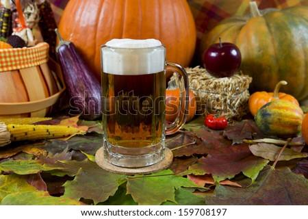 oktoberfest lager beer mug with fall seasonal decoration - stock photo