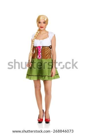 Oktoberfest woman wearing traditional Bavarian dress. - stock photo