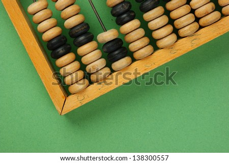 old abacus on the green background - stock photo