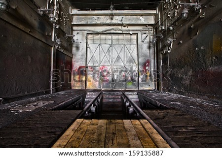 old abandon industrial construction interior, polishing workshop - stock photo
