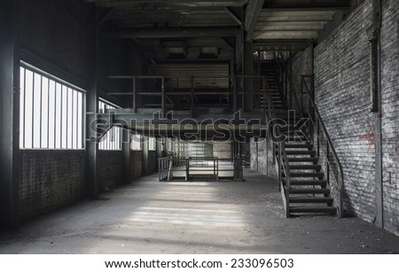 old abandoned building deserted and left to rot with staircase  - stock photo