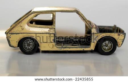 Old abandoned burned car isolated over white - stock photo