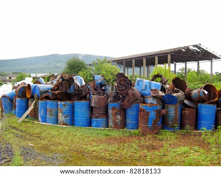 Old abandoned chemical fuel barrels - stock photo