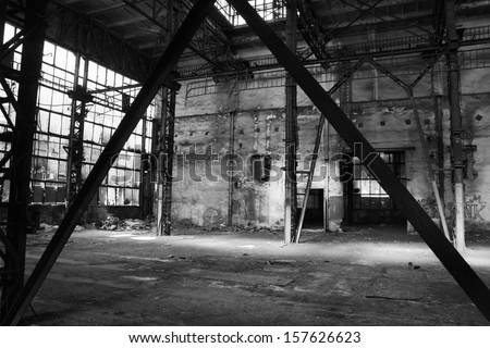 Old abandoned factory hall - stock photo