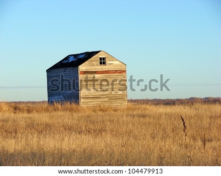 old abandoned farm buildings - stock photo