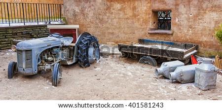 old abandoned farm machinery - stock photo