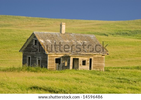 Old Abandoned Homestead on the Prairie - stock photo