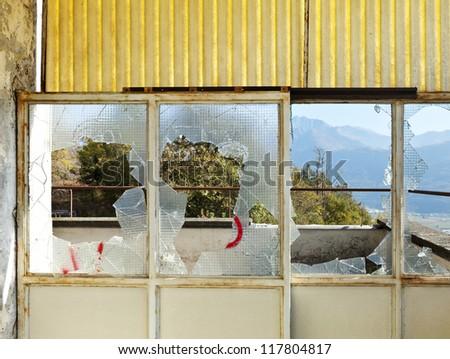 old abandoned house, broken window - stock photo