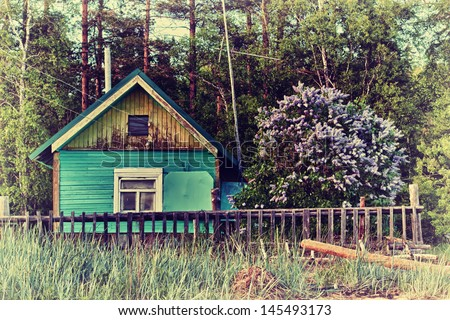 Old abandoned house in the village. - stock photo