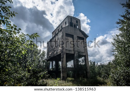 Old abandoned industrial building. - stock photo