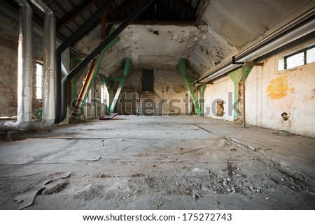 Old Abandoned industrial interior with low light - stock photo