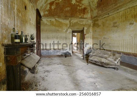 old abandoned living room with sofa - stock photo