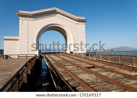 Old Abandoned Railroad Dock and Alcatraz Island - stock photo