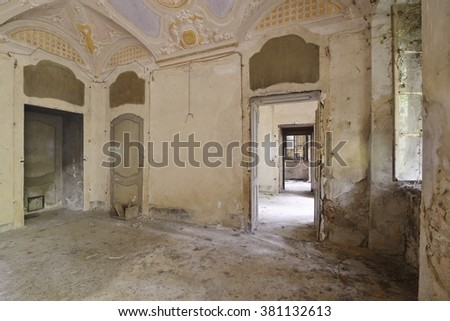Old abandoned room in an ancient villa. - stock photo