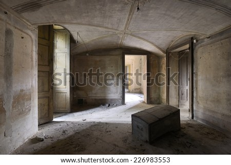 old abandoned room with chest - stock photo