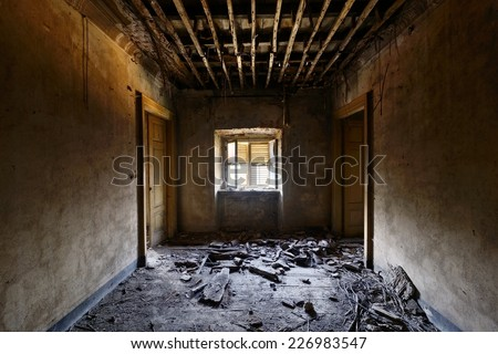 Old abandoned room with window - stock photo