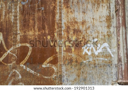old abandoned train station, rusty iron walls, graffiti - stock photo