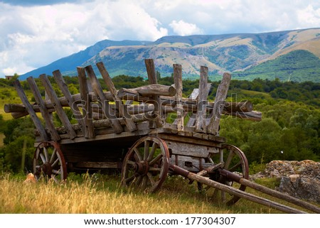 old abandoned wagon requested field - stock photo