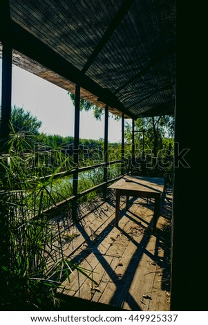 old abandoned wooden cabin in the forest - stock photo