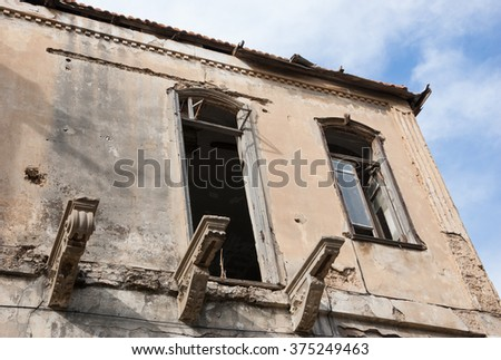 Old abandoned wrecked house. Time concept. - stock photo