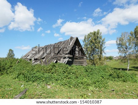Old abounded house in a Russian village - stock photo
