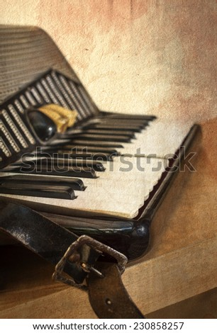 Old accordion instrument in grunge style. Shallow depth of field.  - stock photo