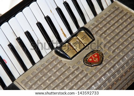 Old accordion instrument. Old accordion. - stock photo