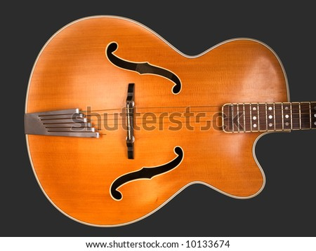 Old acoustic archtop jazz guitar body, isolated on grey c1959 - stock photo